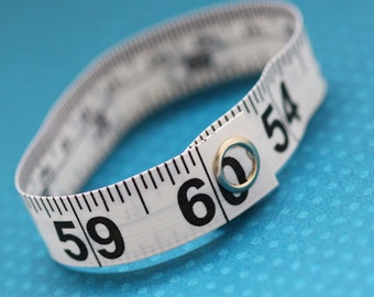 Tape Measure Bracelet in White - Statement Jewelry created with Upcycled Measuring Tape - Vinyl Snap Bracelet - Crafty Repurposed Trashion