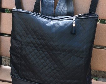 Black Quilted Fabric and Leather Trim Backpack. Knapsack