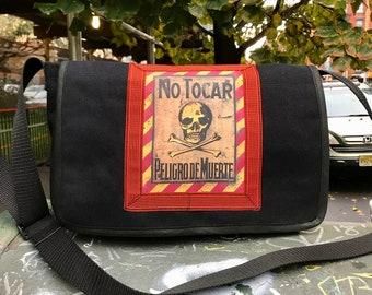 No Tocar Skull and Crossbones Black Canvas Courier Bag, Messenger Bag, Crossbody Shoulder Bag