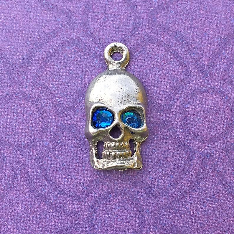 Handmade Skull Charm with Capri Blue Crystal Eyes Lead Free image 0