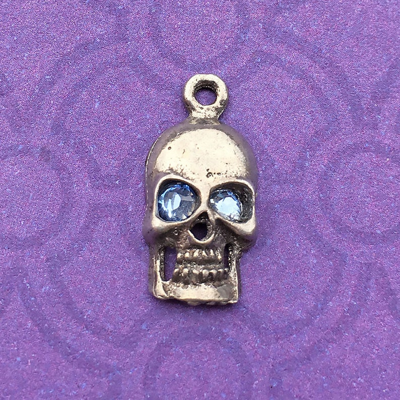 Handmade Skull Charm with Light Sapphire Crystal Eyes about image 0