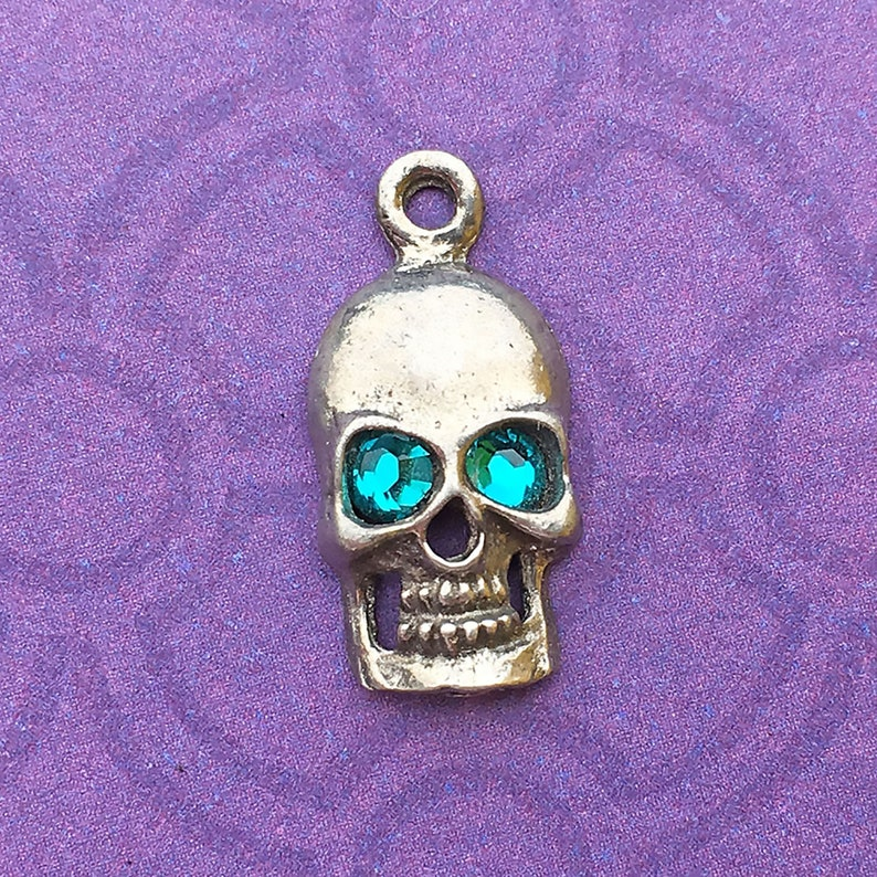 Handmade Skull Charm with Blue Zircon Crystal Eyes December image 0