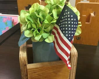 Wooden Box Centerpiece with Cross Cutouts  from Old Wooden Cabinet Doors Holds Fruit Jar of pretty artificial Hydrangeas and American Flag