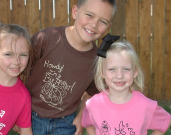 Big Brother and Big Sister Tshirts that have unique screen printed designs exclusive of Glory Bee Baby.
