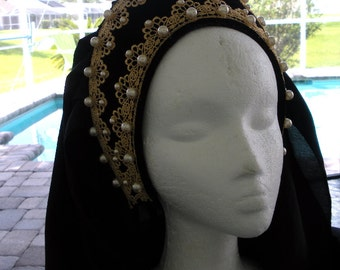 A Homemade Red Tudor Headpiece with Pearls with Flower embroidery and Train of material made in 1990