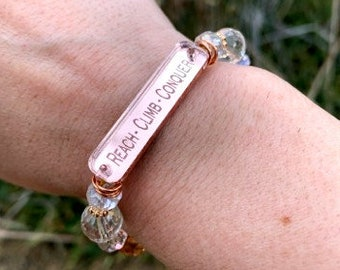 REACH CLIMB CONQUER - Beaded Stretch Bracelet - Rose Gold Mirrored Nameplate
