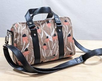 Linen Coneflowers Marcel Barrel Bag, crossbody shoulder handbag with detachable strap, floral fabric and vinyl purse