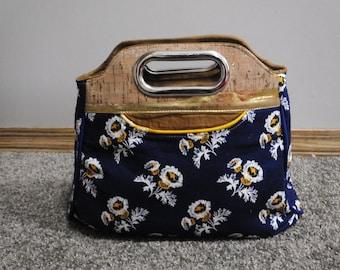 SECONDS Daisies Stargazer clutch style handbag, with cork detail, inside pockets and zipper closure