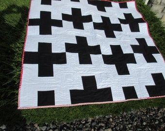 Black and White Modern Crosses Quilt with a bit of red Binding