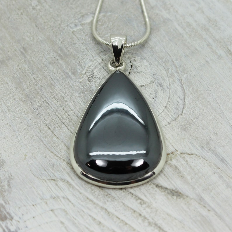 Hematite stone pendant teardrop shape all natural cabochon silver color shiny stone set on sterling silver 925 mount natural quality jewelry