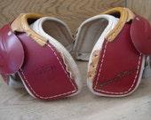 Vintage leather football shoulder pads
