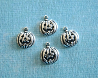 4 Small Silver Jack o'Lantern Charms 3998