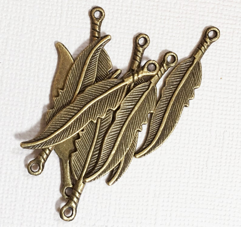 10 pcs  antique brass finished medium feather drop 8x36mm image 1