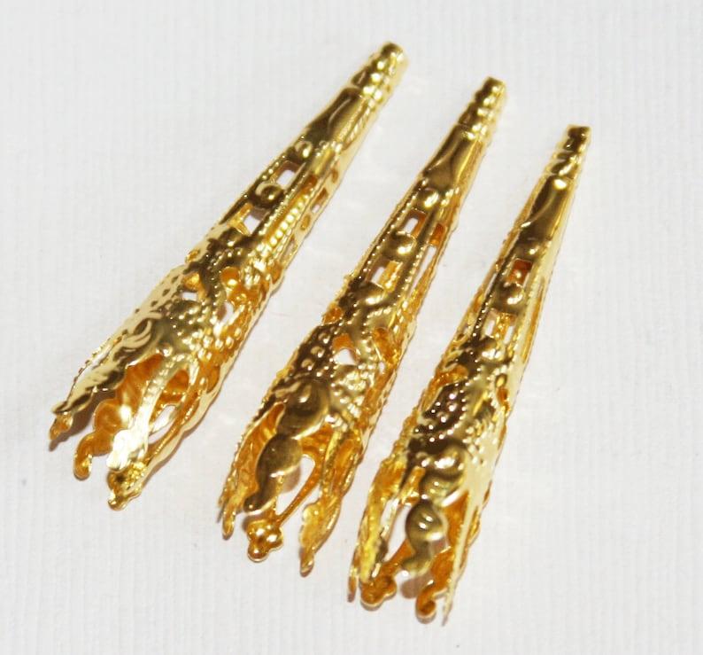 30 pcs of Gold tone finished long filigree cone 41X8mm