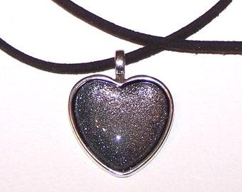 Your Dark Heart necklace on velvet cord