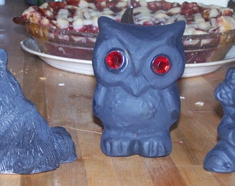 Sinister Ceramics: 3 all-black figurines with red eyes
