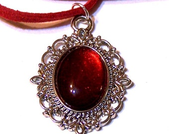 lovely red and silvery pendant on velvet cord