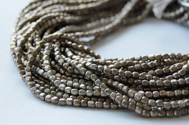 3 mm silver rounded out rectangle metal beads Circle of Stones beads beading supplies bead strands