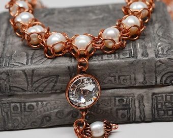 Copper chainmaille necklace with captured pearls and crystal gem
