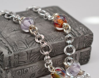 Chainmaille necklace in sterling silver filled with handmade boro glass bead links