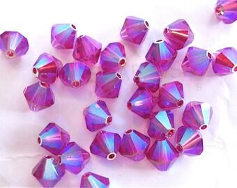 12 Fuchsia AB2X Swarovski Crystals Bicone 5328 6mm