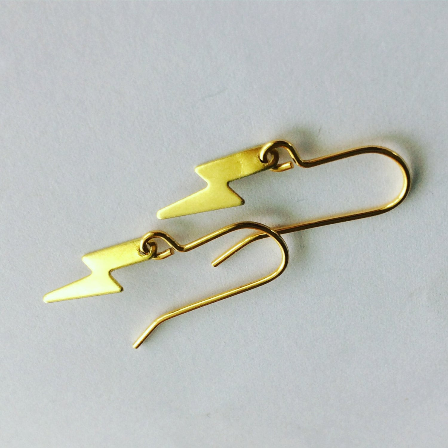 Golden,Brass,Lightening,Bolts,David_Bowie_,brass_earrings_,Faye_wilson_,tiny_earrings_,zigzag_,lightening_bolt_,lightening_earrings_,Ziggy_stardust_,Bowie_earrings_,modern_earrings_,festival,brass_earrings,drop_earrings