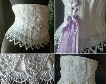 Elysium handmade Victorian wedding bridal steel boned underbust corset featuring steel boning pearlescent brocade coutil and silver lace