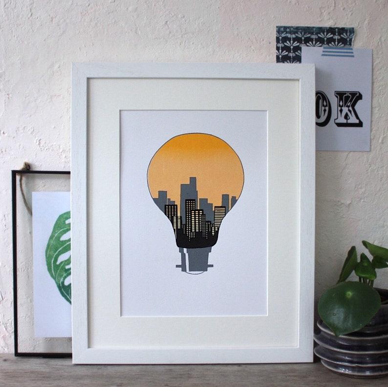 City lights. Light bulb print. Minimalist city silhouette image 0