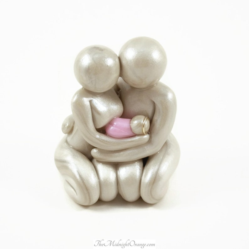 Some Only Dream of Angels  Mother Father and Baby sculpture  image 0