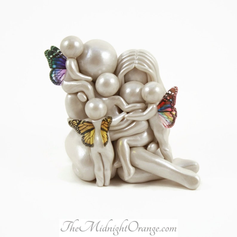 Family of 7 bespoke sculpture with three heavenside babie  image 0