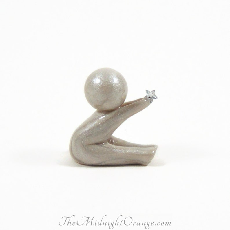 Wish  polymer clay art therapy sculpture of human figure for image 0