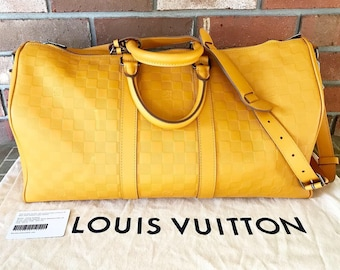 9fa1c7e0f177 Louis Vuitton Damier Infini Leather Bandouliere Keepall Bag 45 in Yellow