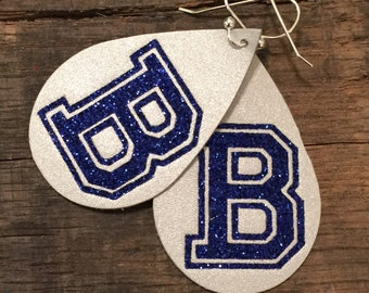 Custom college style letters on leather.  You pick the letter and colors.