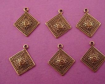 6 brass ox  art nouveau heraldic charms 16mm dapped
