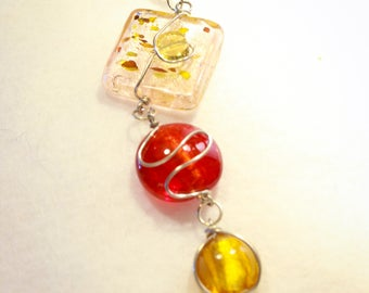 Red gold and rose 3 tiered glass pendant