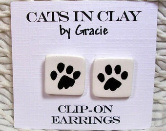 Dog Or Cat Paw Print Clip On Earrings Handmade In Kiln Fired Clay by Grace M Smith