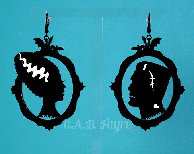 Featured listing image: Frankenstein's Monster & His Bride Earrings - Frankenstein Silhouette Earrings - Laser Cut Acrylic Earrings (C.A.B. Fayre Original Design)