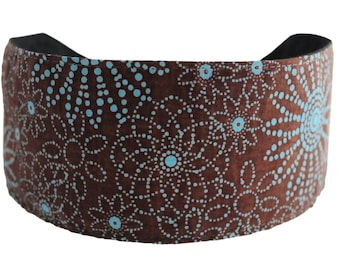 Bargain Headbands, Turquoise Dotted Flowers Over a Chocolate Background.