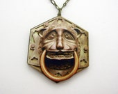 The mournful lion dook knocker necklace