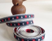 Scandinavian style embroidered ribbon in Navy, Red and White flowers.