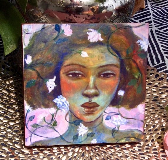 Girl Among Flowers. Print Mounted on wood.