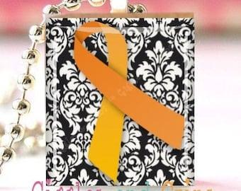 Scrabble Tile Pendant with Free Chain Necklace -- Orange Awareness Ribbon ... Leukemia . Hunger . Cultural Diversity . Humane Treatment of Animals . Self-Injury Awareness