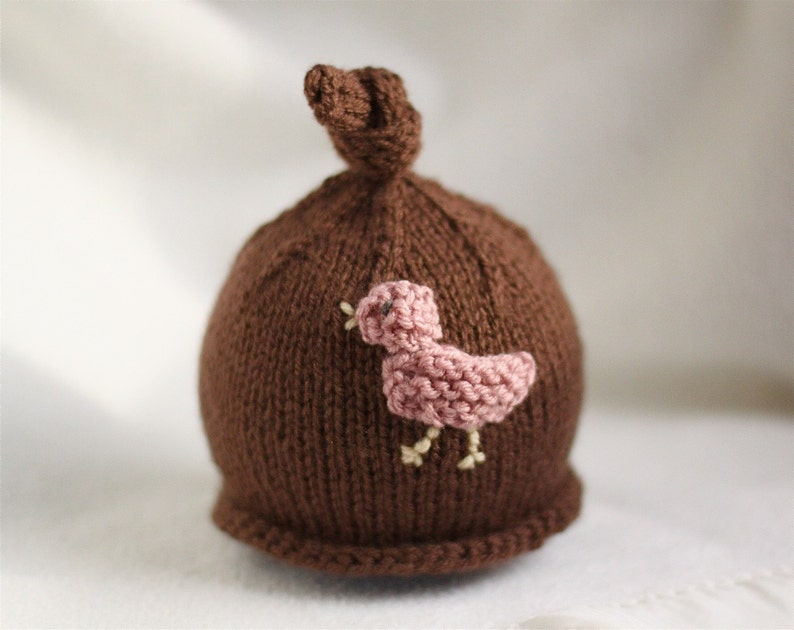 Sizes newborn to big kid available. Baby girl or boy knit hat with bird applique