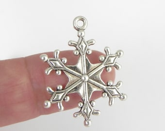 12 Snowflake Charms in Antiqued Silver - two-sided - 28mm x 22mm