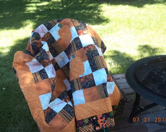 Beautiful patchwork autumn quilt / throw blanket  in orange black white and green with pumpkins, perfect for fall Halloween, harvest quilt