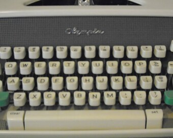 Olympia Deluxe manual vintage typewriter in case with handle