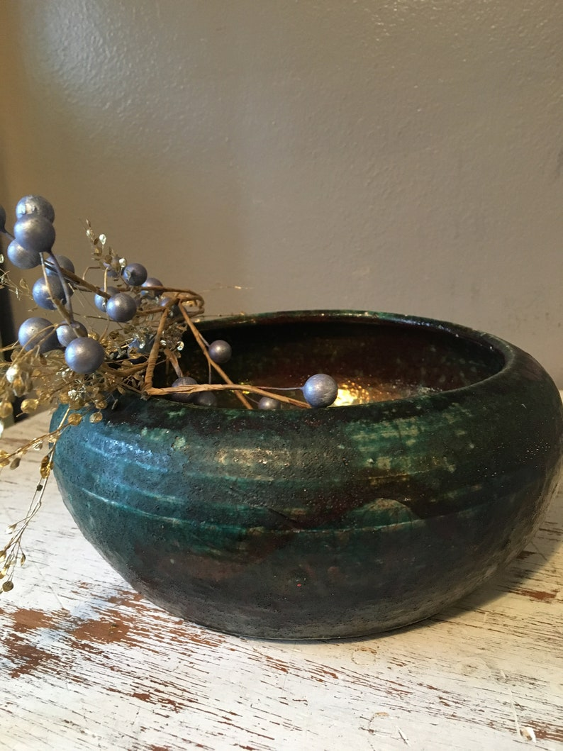 handmade pottery bowl done in deep iridescent coppery blues and greens Small sculpted in 1988 by Tom R Johnson  shallow pottery bowl