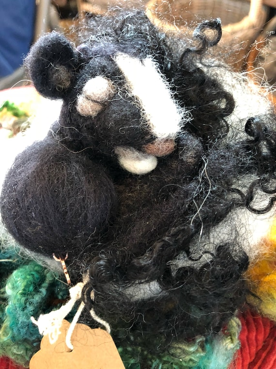Needle Felted Sleeping Baby Skunk