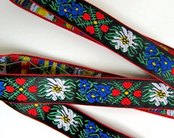 EDELWEISS & HEARTS narrow Jacquard trim White Blue red green yellow on black. Red edges. Sold by the yard. 5/8 inch wide. 956(2)-A Bavarian