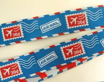 AIR MAIL STAMPS Jacquard trim in red, white on blue. Sold by the yard. 7/8 inch wide. 987-a